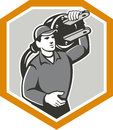 Electrician carry electric plug retro illustration of a worker with carrying on shoulder facing front set inside shield crest on Stock Photo