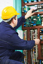 Electrician checking current at power line box Royalty Free Stock Photo