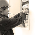Electrician checking fuse box Royalty Free Stock Photography