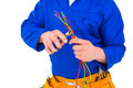 Electrician cutting wire with pliers Royalty Free Stock Photo