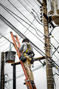 Electrician on electric pole Royalty Free Stock Photo