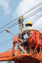 Electrician electricians maintenance and install the power cord on the high pole Stock Photo