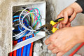Electrician installing a switch socket the hands of an power Royalty Free Stock Photos