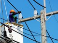 Electrician man working at height and dangerous Royalty Free Stock Photo
