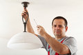 Electrician mounting ceiling lamp Royalty Free Stock Photo