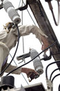 Electrician repair the parts of high voltage transformer on pole Stock Images