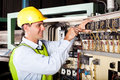 Electrician repairing industrial machine Stock Image