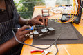 Electrician soldering iron senior african using repair a push button Royalty Free Stock Photo
