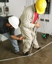 Electrician & Supervisor Bend Pipe Stock Images