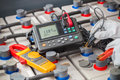 Electrician used digital battery tester Royalty Free Stock Photo
