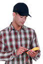 Electrician wearing a cap young using tester Stock Photo