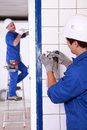 Electrician wiring a wall socket Stock Photo