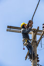 Electrician working on the electricity pole bangkok thailand may to replace electrical insulator Royalty Free Stock Photo