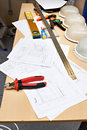 Electrician working place with drawings and tools
