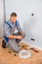Electrician working with wire with plier young in house Royalty Free Stock Image