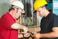 Electricians Repair Circuit Breaker Royalty Free Stock Photo