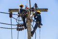 Electricians resting while working on electricity pole bangkok thailand may to replace the electrical insulator the Royalty Free Stock Image