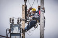 Electricians working on the electricity pole bangkok thailand may together to replace electrical insulator Stock Images