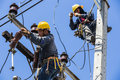 Electricians working together bangkok thailand may to replace the electrical insulator on the electricity pole Stock Photography