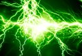 Electricity bright electrical spark on a dark green background Stock Photos