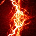 Electricity bright electrical spark on a dark red background Royalty Free Stock Images