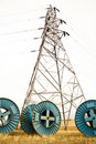 Electricity cable spool and tower Stock Photography