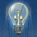 Electricity concept with power line towers distributing with an incandescent light bulb highlighting electrical Stock Image