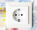 Electricity costs energy prices socket with money appear in the background Royalty Free Stock Photography