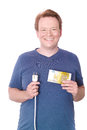 Electricity costs young happy man holding a plug and a euro banknote for your or savings concepts isolated on white Royalty Free Stock Images