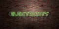 ELECTRICITY - fluorescent Neon tube Sign on brickwork - Front view - 3D rendered royalty free stock picture