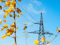 The electricity high voltage electric pillar with wires on a background of autumn sky Royalty Free Stock Photography