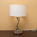 Electricity lamp on wood table Royalty Free Stock Photo