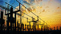 Electricity network at transformer station in sunrise impression high voltage up to yellow sky Stock Images