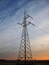 Electricity pole an over a colred sky at sunset Royalty Free Stock Photography