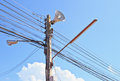 Electricity post in blue sky and clouds Stock Photography