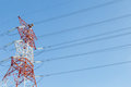Electricity power line pylon single against blue sky Royalty Free Stock Photos