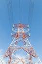 Electricity power line pylon single against blue sky Royalty Free Stock Image