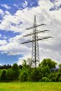 Electricity power pole against a cloudy blue sky Royalty Free Stock Photos