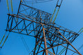 Electricity pylon against the blue sky Royalty Free Stock Photos