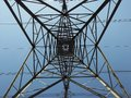 Electricity pylon from below showing geometric pattern Royalty Free Stock Photo