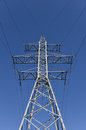 Electricity pylon blue sky with cable background Stock Image