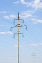 Electricity pylon jn blue sky background Stock Photo
