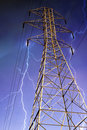 Electricity Pylon with Lightning in Background. Stock Images