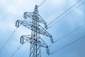 Electricity pylon with power lines against blue sky Royalty Free Stock Photo
