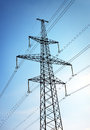 Electricity Pylon and Power Lines on Blue Sky Royalty Free Stock Photo