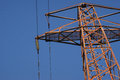 Electricity pylon set against clear blue sky Royalty Free Stock Photography