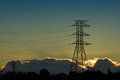 Electricity pylon silhouetted at sunrise or sunset Stock Image