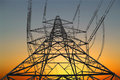 Electricity pylon at sunset Stock Photo