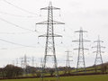 Electricity pylons dominating the landscape a section of english countryside Stock Images