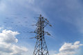 Electricity pylons and line against the blue sky clouds Stock Images